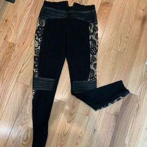 Bebe cutout lace detail Moto leggings.